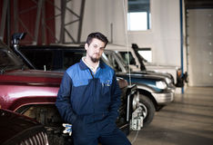 Car mechanic at work Stock Images