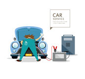 Car Mechanic workers in blue car service Stock Photography