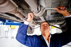 Car mechanic working Stock Images