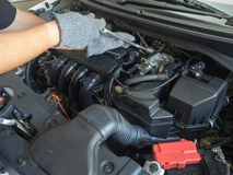 Car mechanic working in auto repair service. Car mechanic working in auto repair service Stock Images