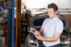 Car Mechanic Working In Auto Repair Shop stock images