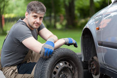Car mechanic working outdoors Royalty Free Stock Photos