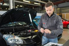 Car mechanic working with tool in service workshop. Car stock photos