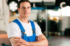 Car mechanic in workshop Royalty Free Stock Image