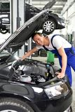 Car mechanic in a workshop - engine repair and diagnosis on a ve. Hicle royalty free stock photo