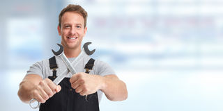 Car mechanic. Car mechanic with wrench in auto repair service garage Royalty Free Stock Image