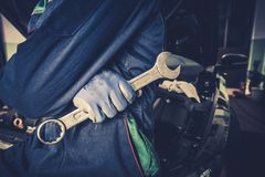 Car Mechanic with Wrench. Car Mechanic with Huge Wrench Preparing For Car Maintenance and Big Fix Stock Image