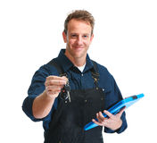Car mechanic. Young handsome car mechanic with keys isolated white background royalty free stock image