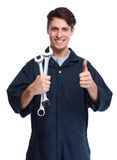 Car mechanic. Young handsome car mechanic with wrench isolated white background royalty free stock photos