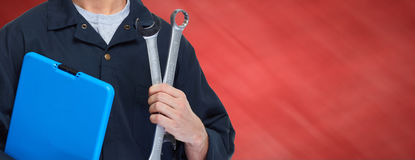 Car mechanic. Young professional auto mechanic with wrench. Tire changing stock photo