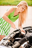 Car mechanician repairs engine Stock Images