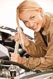 Car mechanician repairs engine royalty free stock image