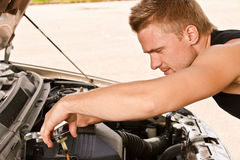 Car mechanician repairs engine Royalty Free Stock Photo