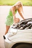Car mechanician repairs engine Royalty Free Stock Images