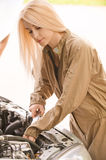 Car mechanician repairs engine Stock Photo