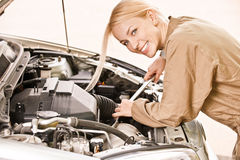 Car mechanician repairs engine Royalty Free Stock Images