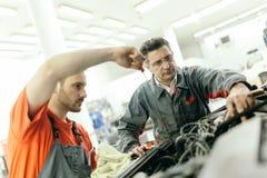 Car mechanics fixing car Stock Photos