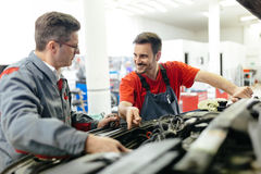 Car mechanics fixing car Stock Photography