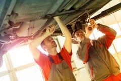 Car mechanics fixing car Royalty Free Stock Photography