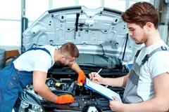 Car mechanics at the service station Stock Photos