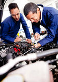 Car mechanics working Royalty Free Stock Photos