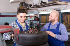 Car mechanics  working at carshop Royalty Free Stock Images