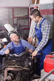 Car mechanics  working at carshop Royalty Free Stock Photography