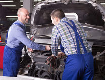 Car mechanics  working at carshop Stock Image
