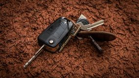 Car Metal Key Ring On Brown Texture stock photo