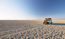 Car in the middle of salt lake near Kubu island Stock Photo