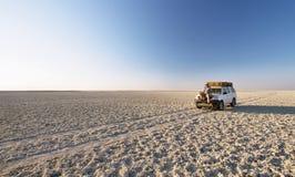 Car in the middle of salt lake near Kubu island stock photo