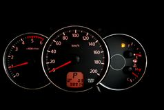 Car mileage monitor with Empty fuel warning light.  Stock Images