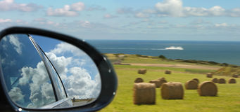 Car mirror and sea landscape royalty free stock images