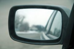 Car mirror. Mirror in focus, reflection blurred Stock Photography