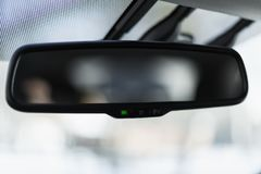 Car mirror with adaptive dimming system. Auto brightness control royalty free stock photos