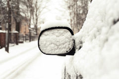 Car mirror covered of snow. Outside Royalty Free Stock Images