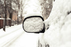 Car mirror covered of snow. Outside Stock Images