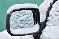 Car mirror covered with snow royalty free stock photos