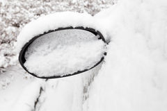 Car mirror filled with snow Royalty Free Stock Photos