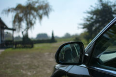Car mirror in focus Royalty Free Stock Image