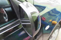 Car. Mirror, mirror in focus, reflection blurred Royalty Free Stock Photography