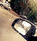 Car mirror after rain Royalty Free Stock Images