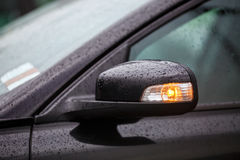 Car mirror with rain drops Royalty Free Stock Image