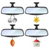 Car mirror set with different decorations. Like dices, star, ball and house Royalty Free Stock Photography