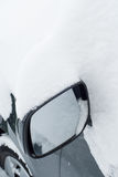 Car mirror in snow Royalty Free Stock Photo