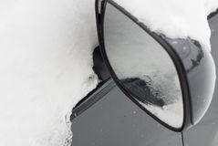 Car mirror in snow Stock Images