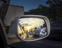 Car mirror. Sunset in the rearview mirror Royalty Free Stock Image