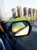 Car and rear view mirror. Car,road,cloud and rear view mirror Royalty Free Stock Photos