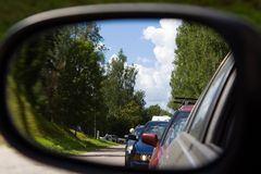 Car mirror traffic jam Stock Photo