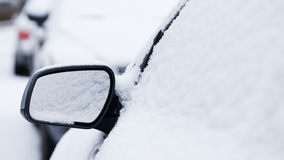 Car mirror under snow Royalty Free Stock Photo